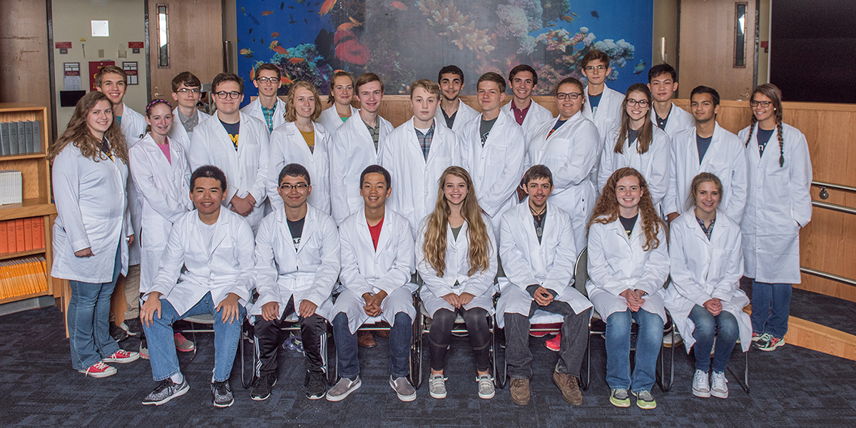 Group of students in lab coats