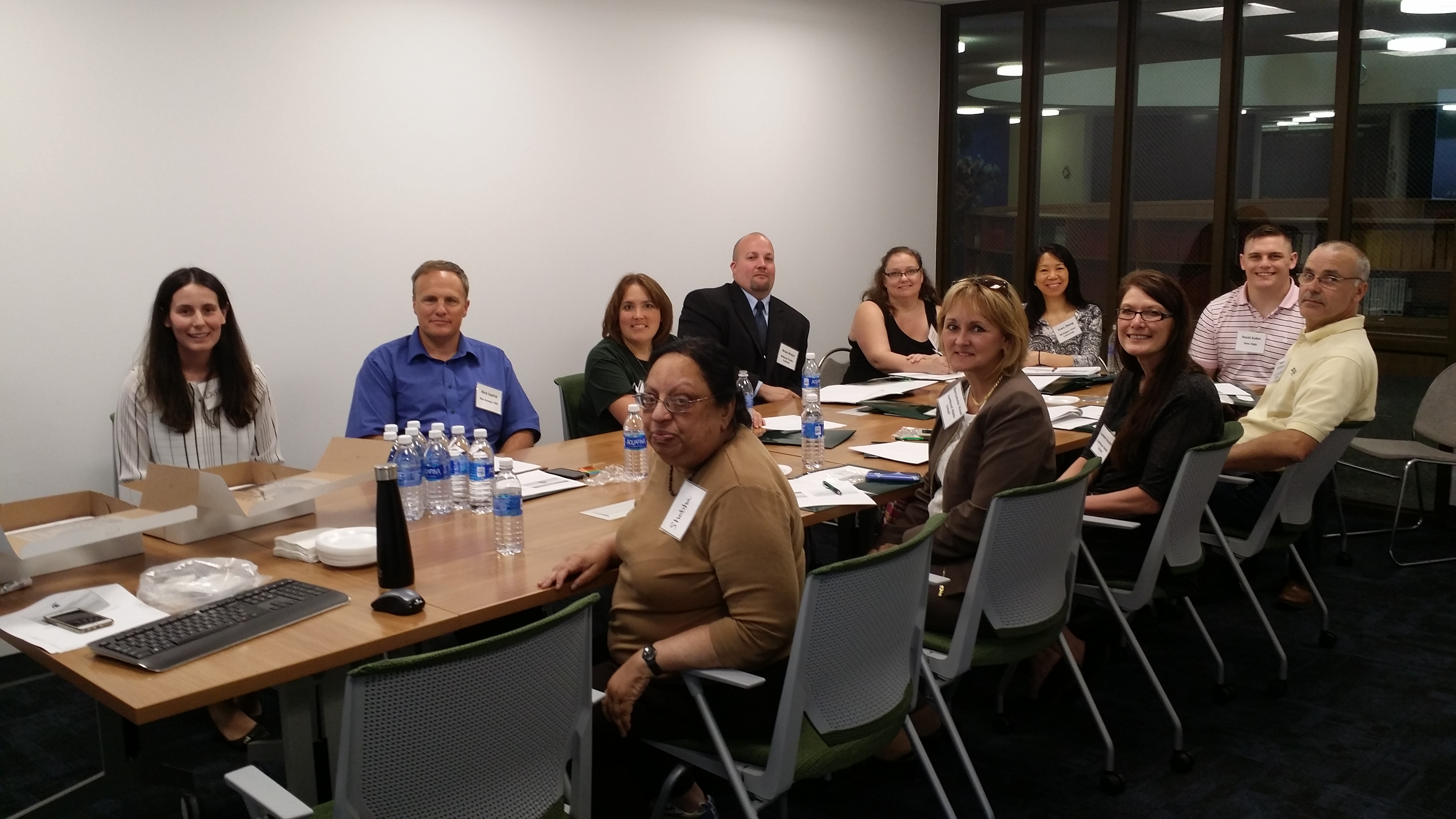 Teachers participating in a workshop around a conference table