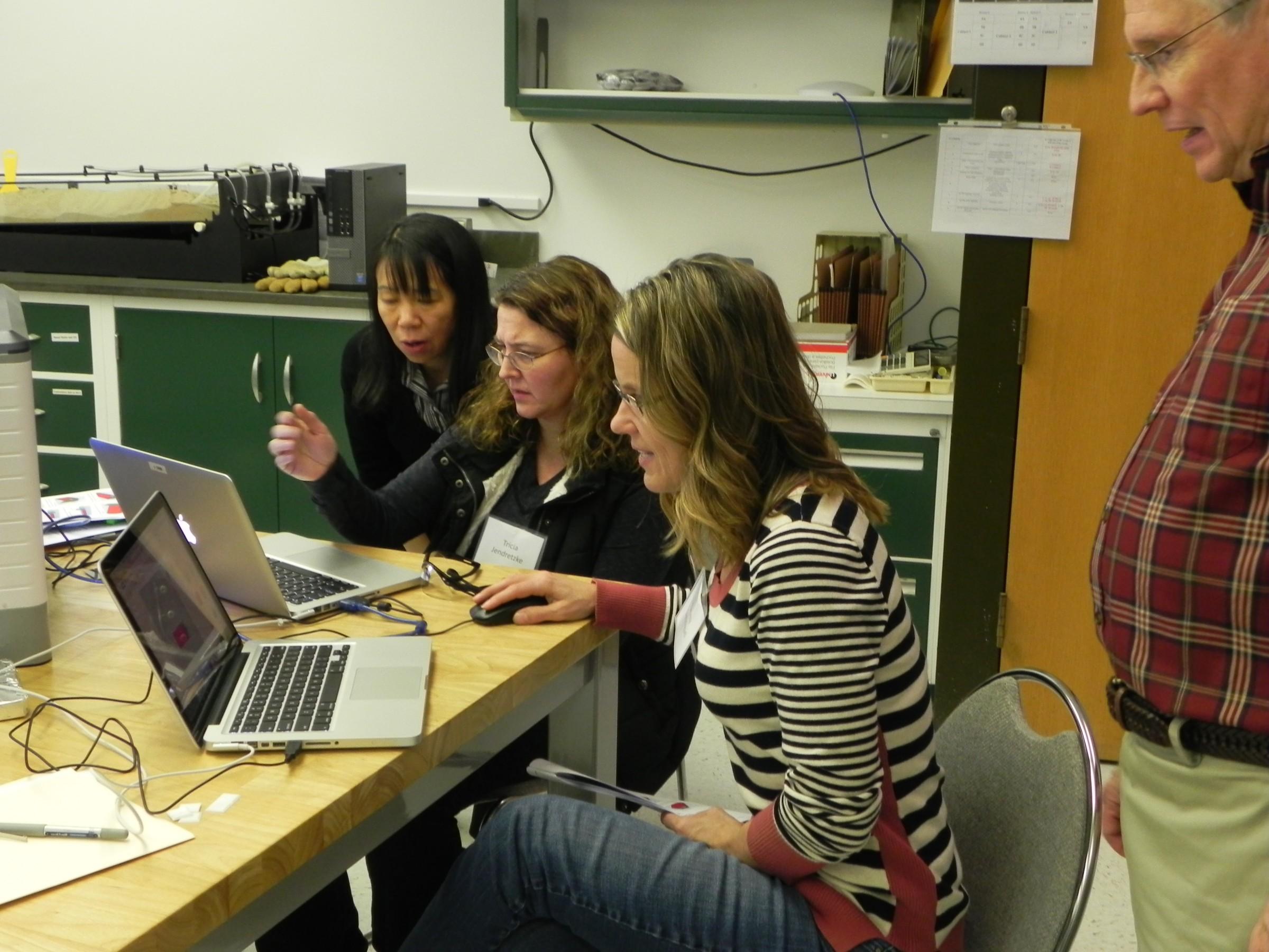 Teachers gathered around a computer