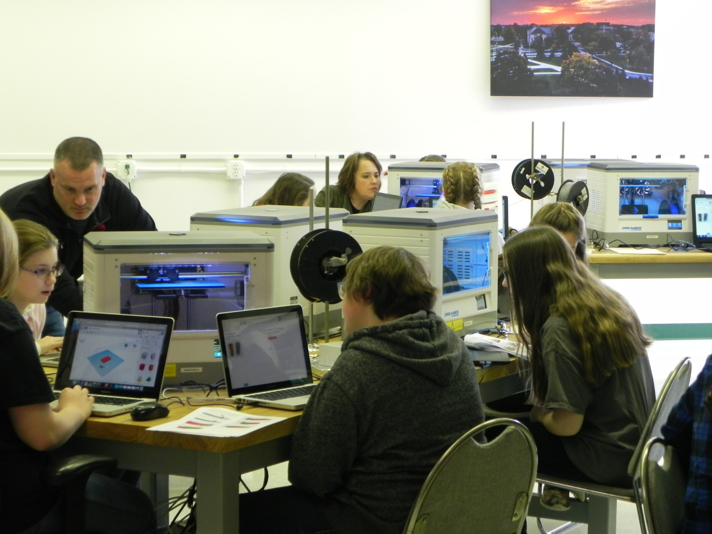 Students using laptops and 3D printers