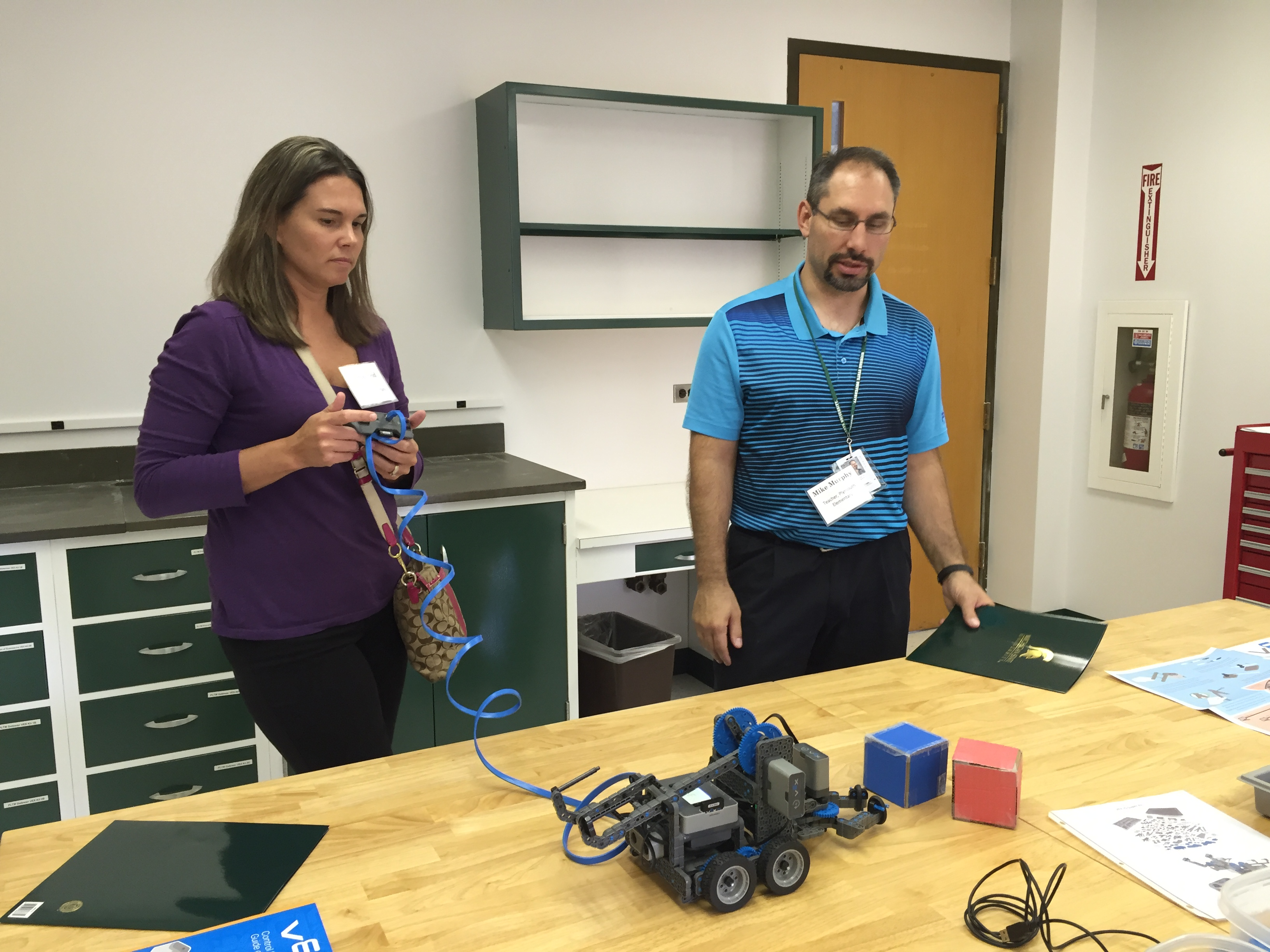 Two teachers working on 3D printing project