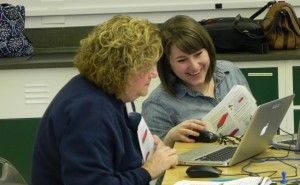 Two female teachers working on laptop