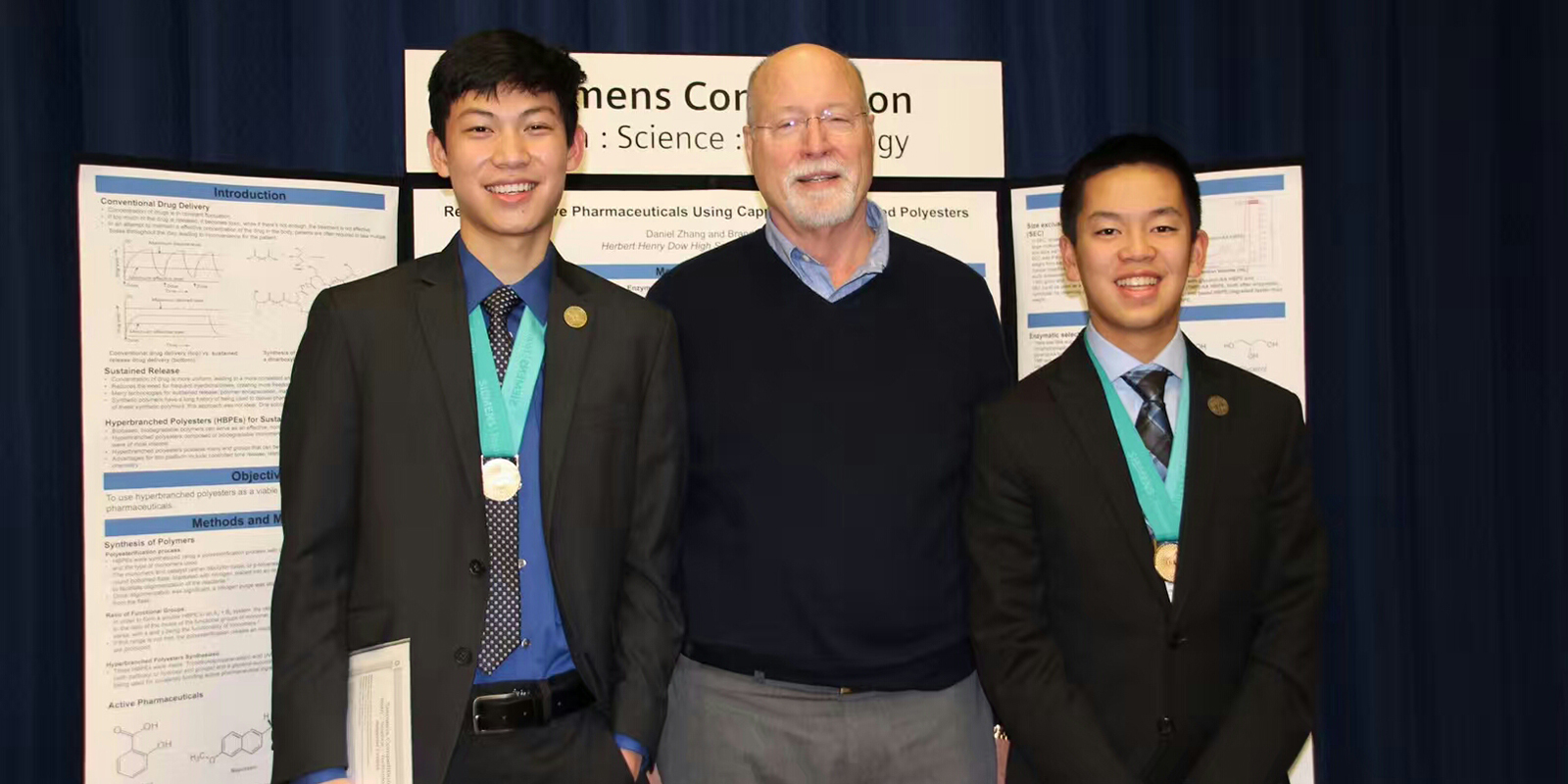 Group photo with two students and mentor at science competition