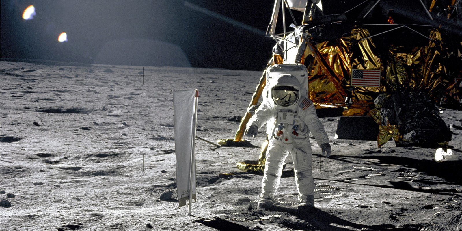 Image of astronaut on moon with landing equipment behind him from 1969 Apollo 11 mission