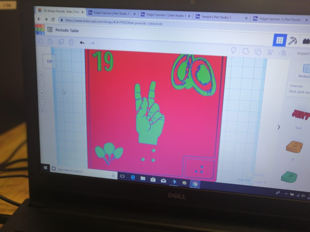 Image of computer screen with pink design on it
