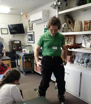 Edmund Start demonstrating a pair of skiis