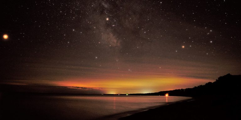 Evening landscape featuring stars in the sky