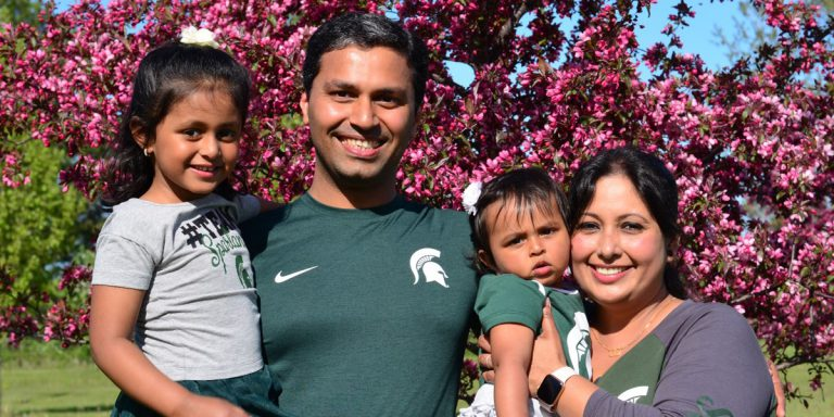 Image of The Bambhania family is Spartan green: Harleen, 4, Harshal (MS, '11), Ashleen, 1, and Deboleena Chakraborty (PhD, '10).