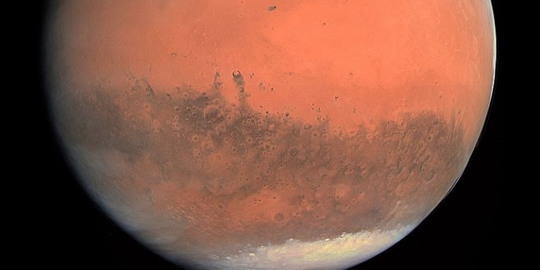 Image of The planet Mars with visible Martian polar ice caps.