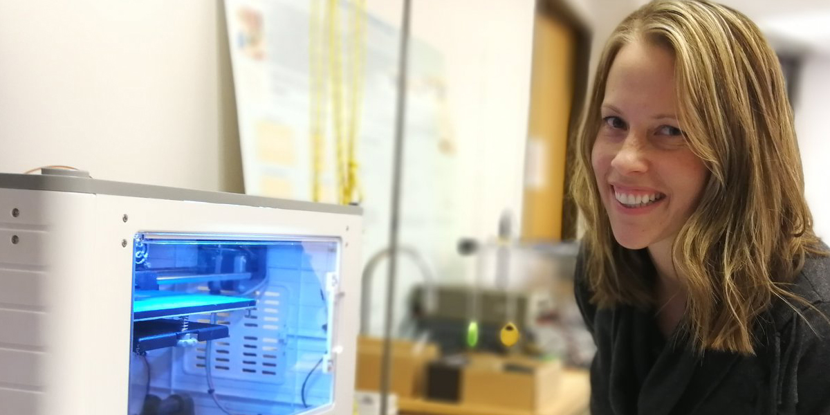 Image of teacher with 3D printer.