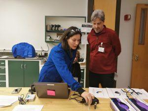 Image of scientist demonstrating Vernier sensor.